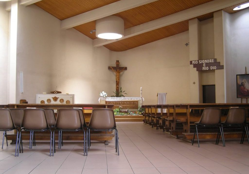 small chapel with chairs and cross