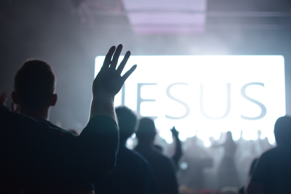 people worshipping with a large led screen